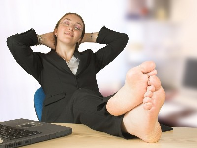 business woman with her feet up at the office